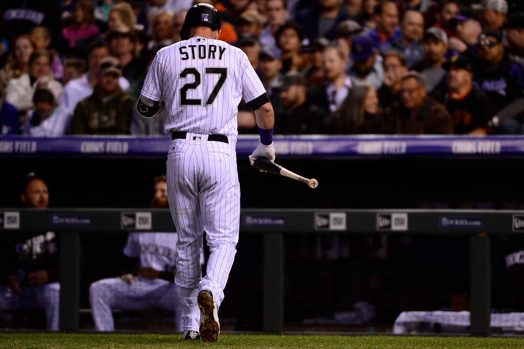 . DENVER, CO - APRIL 12: Colorado Rockies shortstop Trevor Story (27) walks back to the dugout after striking out during the third inning at Coors Field on April 12, 2016 in Denver, Colorado. San Francisco Giants defeated the Colorado Rockies 7-2. (Photo by Brent Lewis/The Denver Post)