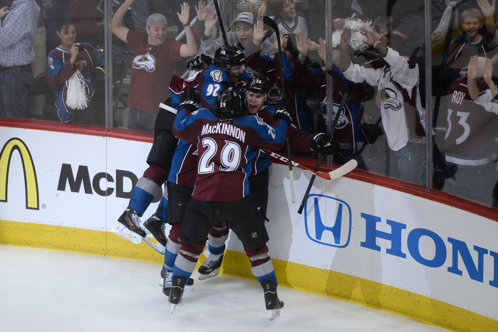 . Paul Stastny (26) of the Colorado Avalanche celebrates his game-winning goal with teammates Tyson Barrie (4), Gabriel Landeskog (92) and Nathan MacKinnon (29) during the overtime period of the Avs\' 5-4 win. The Colorado Avalanche hosted the Minnesota Wild during the first round of the NHL Stanley Cup Playoffs at the Pepsi Center on Thursday, April 17, 2014. (Photo by Karl Gehring/The Denver Post)