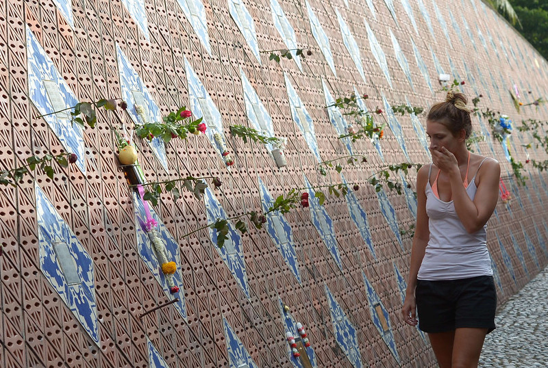 . A foreign tourist visits the Ban Nam Khem tsunami memorial park wall on the tenth anniversary of the 2004 tsunami in Phang-nga province on December 26, 2014.  Prayer recitals and solemn visits to mass graves marked the start of mourning on December 26 across tsunami-hit nations for the 220,000 people who perished when giant waves decimated coastal areas of the Indian Ocean a decade ago.  PORNCHAI KITTIWONGSAKUL/AFP/Getty Images