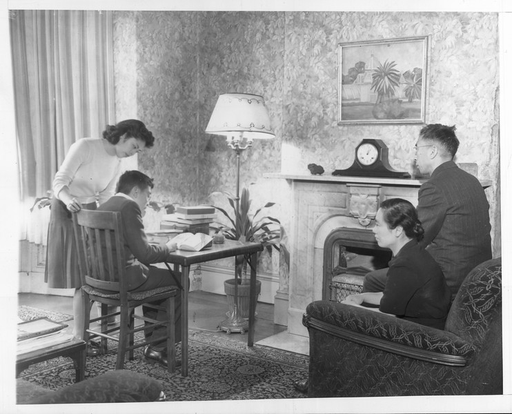 """""""They're Japanese -- but loyal Americans.  Here is another typically American scene in the home of a loyal Japanese-American family"""" -- caption on photograph"""