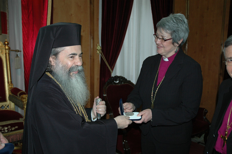 Beatitude Theofilos III, Greek Orthodox Patriarch of Jerusalem, presents a gift to ELCIC National Bishop Susan Johnson Jan. 9 in Jerusalem.