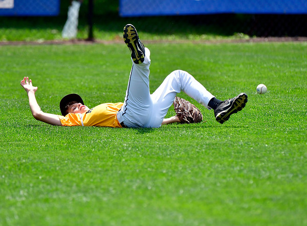 8/9/2019 Mike Orazzi | Staff Connecticut's Rocco Zagami (26) attempts a diving catch during a 4-0 loss to Rhode Island during the semi-final in the New England Regional Baseball game at Breen Field in Bristol on Friday.