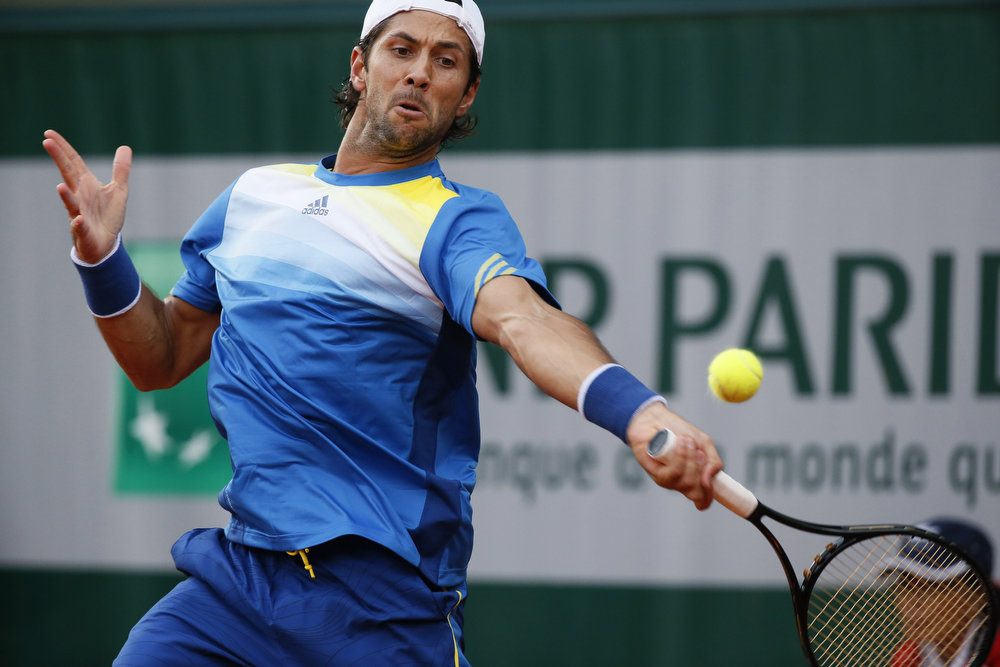 . Spain\'s Fernando Verdasco hits a forehand shot to France\'s Marc Gicquel during a French tennis Open first round match at the Roland Garros stadium in Paris on May 28, 2013. KENZO TRIBOUILLARD/AFP/Getty Images