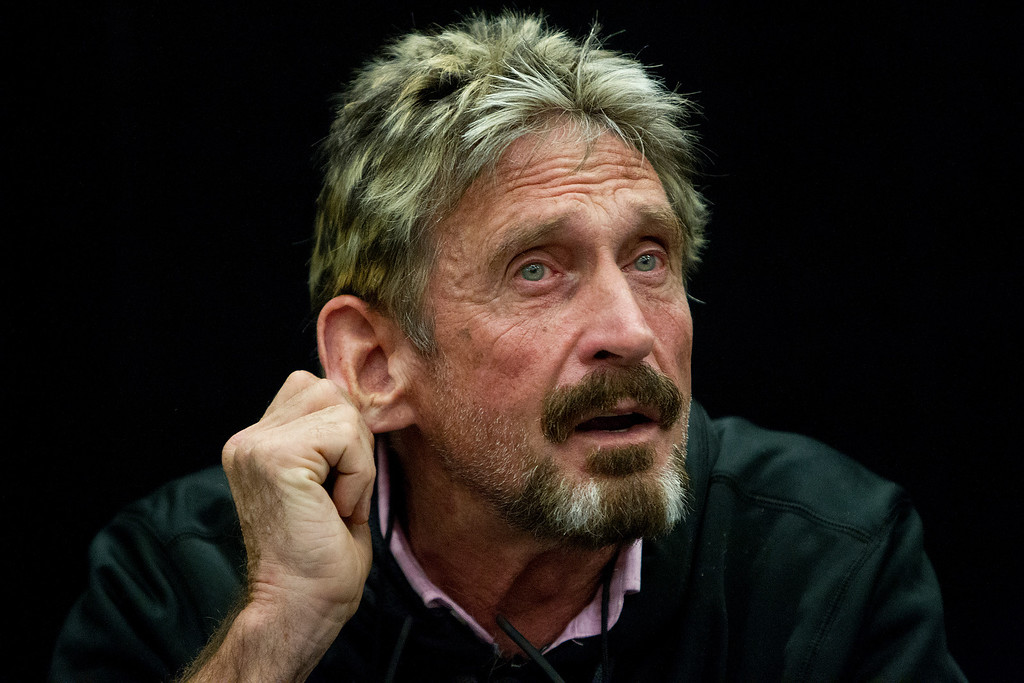 """. John McAfee listens to a question at the \""""Fireside Chat with John McAfee\"""" talk during the C2SV Technology Conference + Music Festival at the McEnery Convention Center in San Jose, Calif., on Saturday, Sept. 28, 2013.   (LiPo Ching/Bay Area News Group)"""