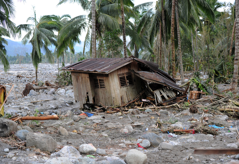 . A house wrecked by flash floods at the height of Typhoon Bopha sits next to boulders in New Bataan town, Compostela Valley province on December 5, 2012. At least 274 people have been killed and hundreds remain missing in the Philippines from the deadliest typhoon to hit the country this year, the civil defence chief said December 5.  TED ALJIBE/AFP/Getty Images