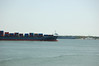 August 6, 2009<br /> A containership heads out of Charleston Harbor through the shipping channel with the aircraft carrier Yorktown behind it. (Photo/Andy Owens)
