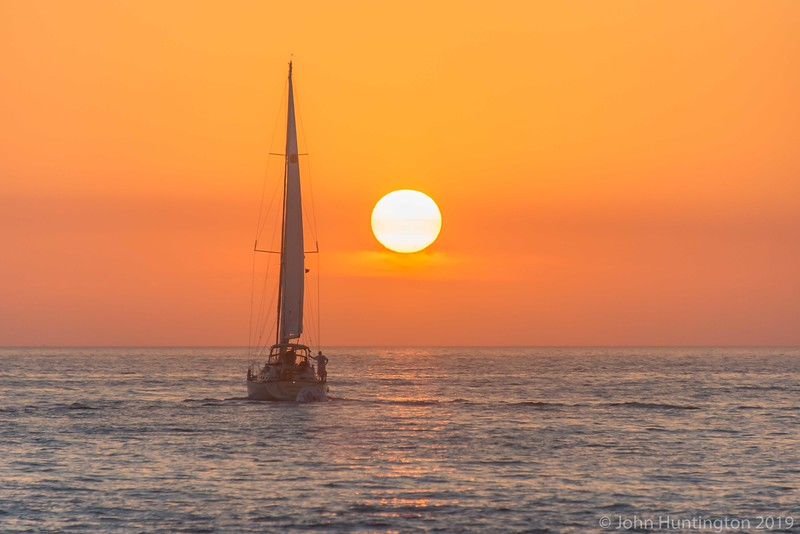 A ship sails by the sunset off Key West, Florida.