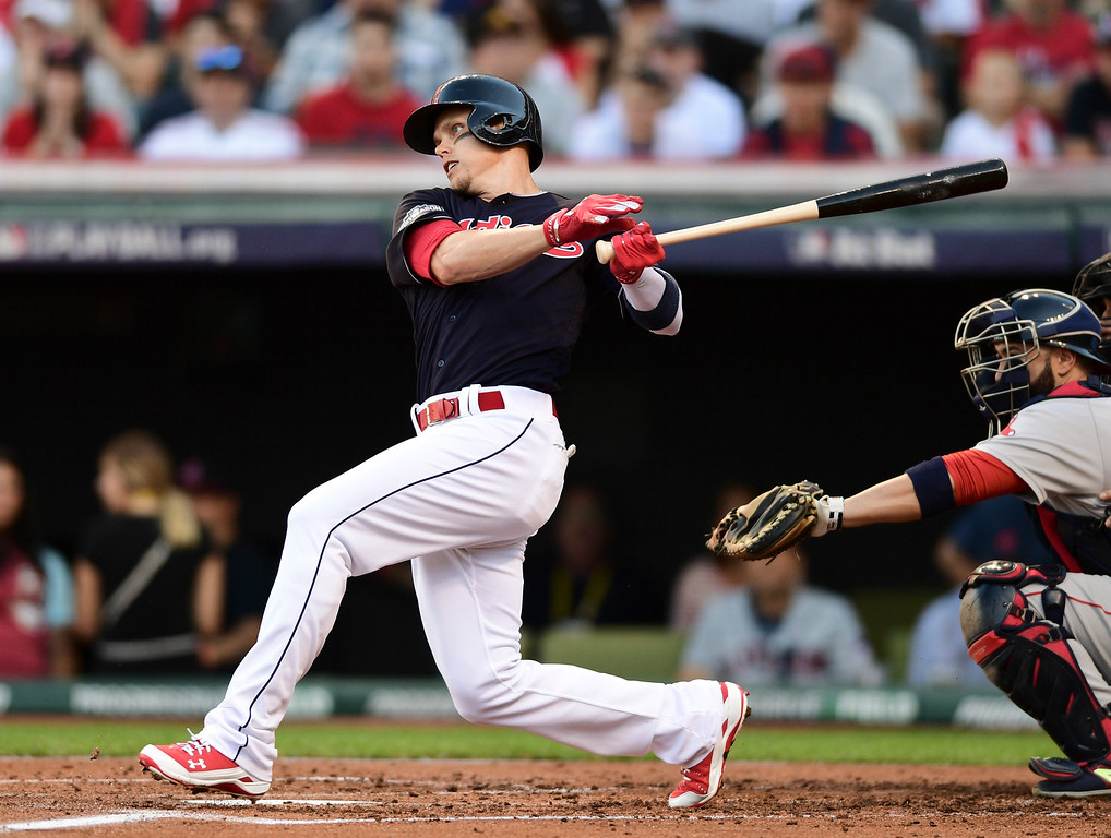 . Cleveland Indians\' Brandon Guyer hits a one-run single against the Boston Red Sox in the second inning during Game 2 of baseball\'s American League Division Series, Friday, Oct. 7, 2016, in Cleveland. (AP Photo/David Dermer)