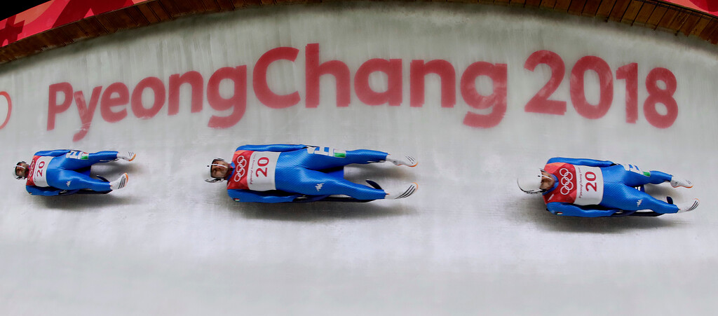 . In this multiple exposure photo, Emanuel Riedel, of Italy, makes his third run during final heats of the men\'s luge competition the 2018 Winter Olympics in Pyeongchang, South Korea, Sunday, Feb. 11, 2018. (AP Photo/Charlie Riedel)