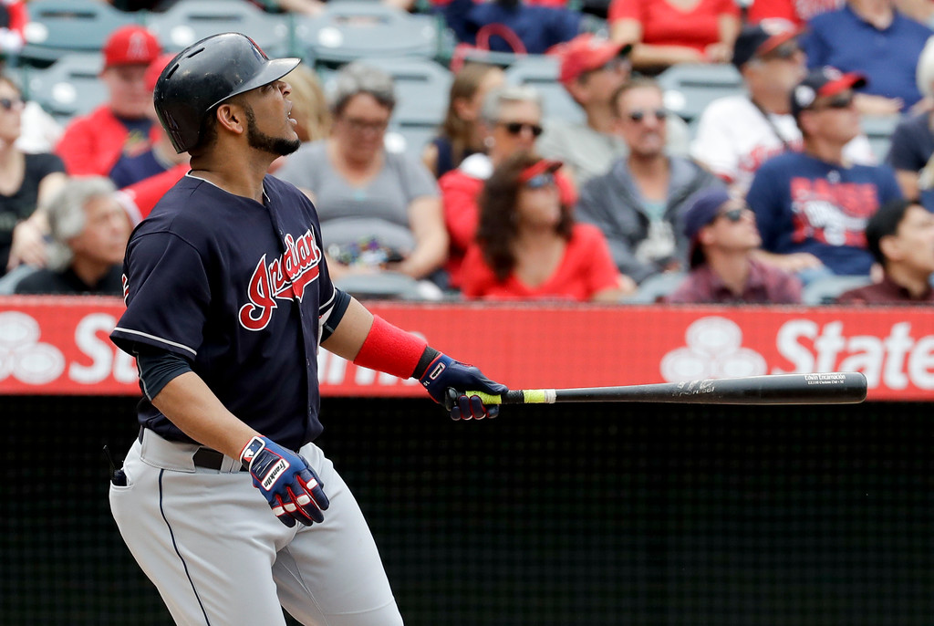 . Cleveland Indians\' Edwin Encarnacion watches his home run against the Los Angeles Angels during the second inning of a baseball game in Anaheim, Calif., Thursday, Sept. 21, 2017. (AP Photo/Chris Carlson)