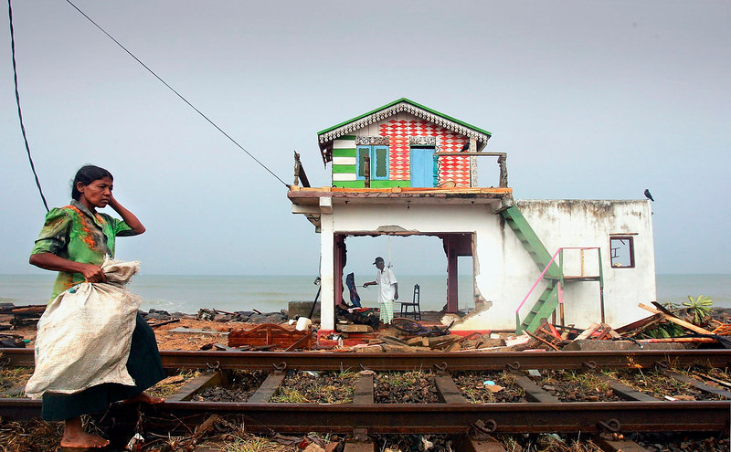 . A husband and wife inspect the remains of their home on the coast of the Ratmalana district after the massive tsunami wave swept across coastal Sri Lanka, December 28, 2004 in Colombo, Sri Lanka. Over 29,000 people have been killed across southern Asia, after the strongest earthquake in the world for 40 years generated a wall of water that sped across thousands of kilometers of ocean. The 9.0 magnitude quake struck under the sea near Aceh in North Indonesia. Sri Lankan officials estimate more than a million people have been forced from their homes. (Photo by Scott Barbour/Getty Images)