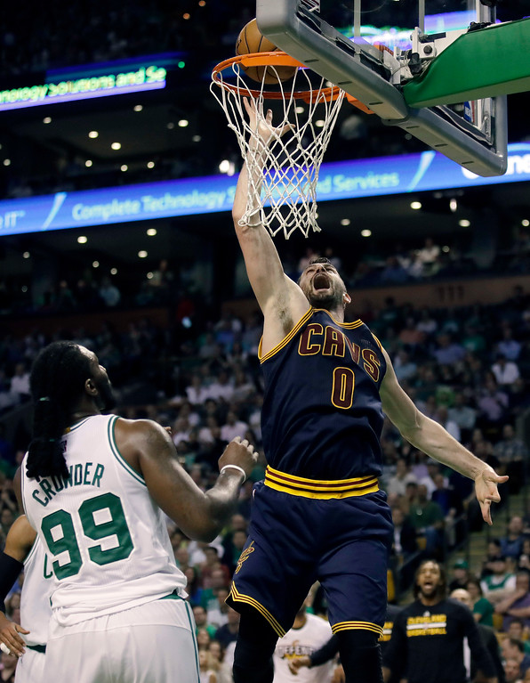 . Cleveland Cavaliers forward Kevin Love, right, shoots over Boston Celtics forward Jae Crowder during the second quarter of Game 1 of the NBA basketball Eastern Conference finals, Wednesday, May 17, 2017, in Boston. (AP Photo/Charles Krupa)