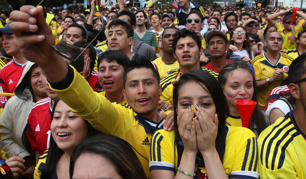 . Colombia soccer fans cheer during their team\'s soccer World Cup game against Greece in Bogota, Colombia, Saturday, June 14, 2014. Colombia defeated Greece 3-0. (AP Photo/Javier Galeano)