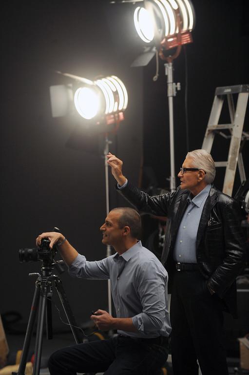 . Art Van Elslander, owner of Art Van Furniture gives the OK during a photo shoot with internationally renowned fashion photographer Nigel Barker. Macomb Daily File Photo/DAVID DALTON