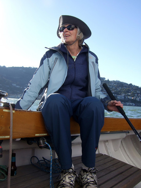 "Joan Wheeler, lady friend of Ron Young - Sailing on San Francisco Bay on Ron Young's classic wooden boat ""Youngster"""