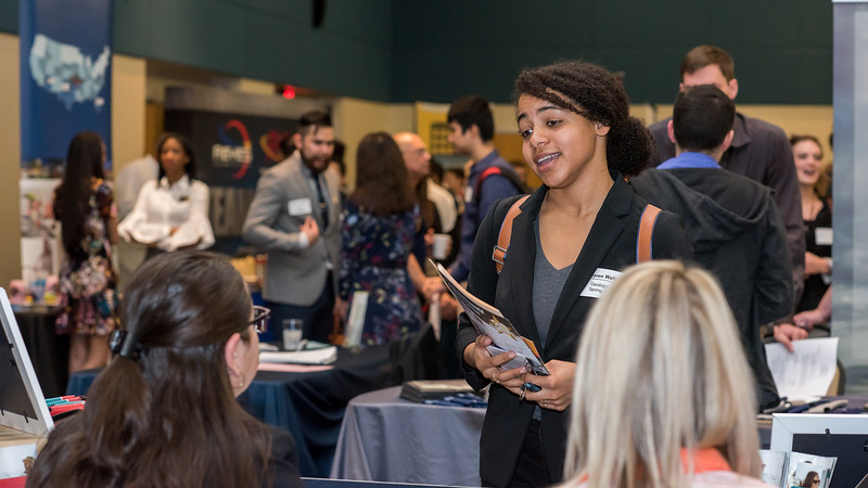 Student Loren Wallor speaks to recruiters during the Career Service's Career Fair held in the University Center's Lonestar Ballroom.
