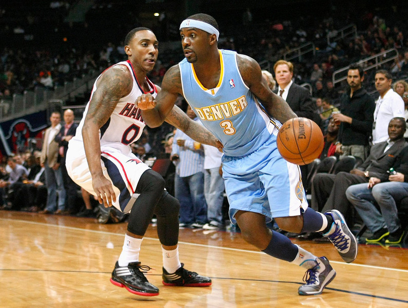 . Denver Nuggets guard Ty Lawson (R) drives against Atlanta Hawks guard Jeff Teague in the first half of their NBA basketball game in Atlanta, Georgia  December 5, 2012. REUTERS/Tami Chappell
