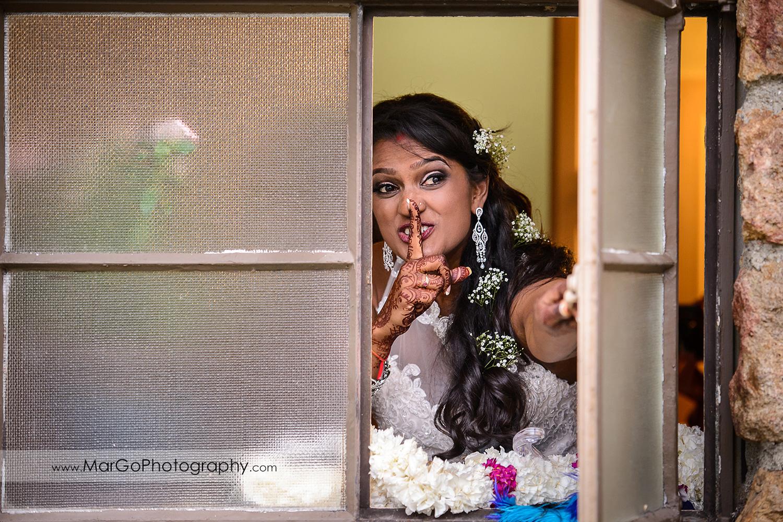 bride in the window in white wedding dress at Brazilian Room - Tilden Regional Park, Berkeley
