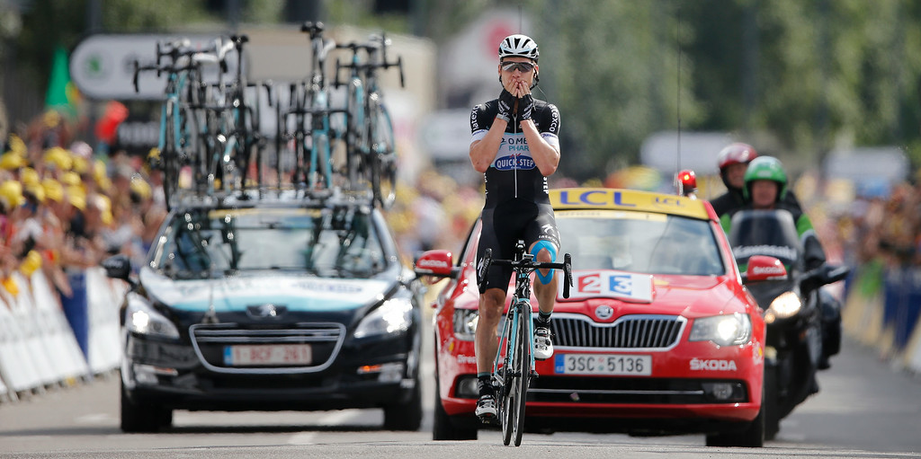. Germany\'s Tony Martin crosses the finish line to win the ninth stage of the Tour de France cycling race over 170 kilometers (105.6 miles) with start in Gerardmer and finish in Mulhouse, France, Sunday, July 13, 2014. (AP Photo/Peter Dejong)