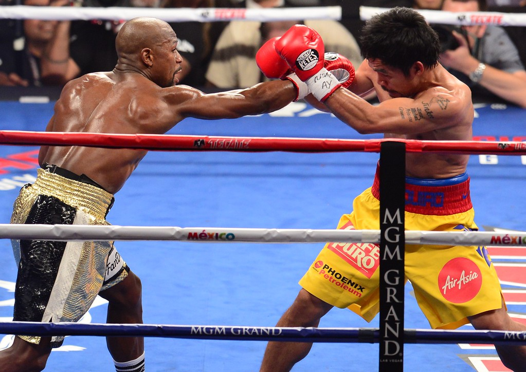 . Floyd Mayweather Jr., and Manny Pacquiao (R) fight in a welterweight unification bout on May 2, 2015 at the MGM Grand Garden Arena in Las Vegas, Nevada. AFP PHOTO / FREDERIC J. BROWNFREDERIC J. BROWN/AFP/Getty Images