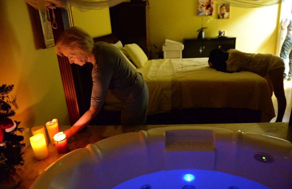 . Midwife Simona Istrate lights candles in the birthing room as Lilibeth Salas, of El Monte, works through a contraction at the Natural Birth Center and Women\'s Wellness in Whittier on December 29, 2013. Birthing centers and home births are becoming more popular and the Birth Center in Whittier is doing so well it opened a second office in Beverly Hills. (Staff Photo by Keith Durflinger/Whittier Daily News)