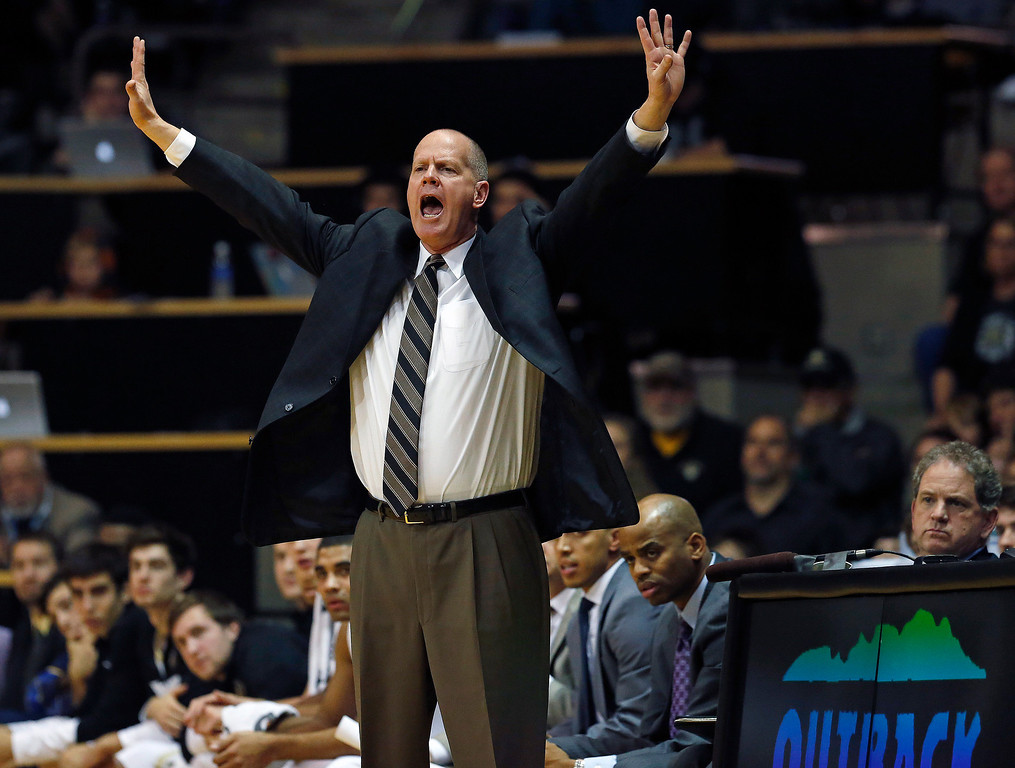 . Colorado\'s head coach Tad Boyle gestures to his players during an NCAA college basketball game against Elon in Boulder, Colo., Friday, Dec. 13, 2013. (AP Photo/Brennan Linsley)