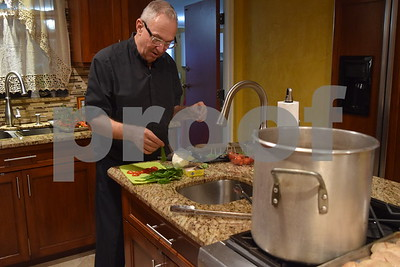 Father Harris Cooking Dinner