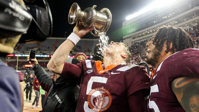 QB Ryan Willis takes a drink from the Commonwealth Cup. (Mark Umansky/TheKeyPlay.com)