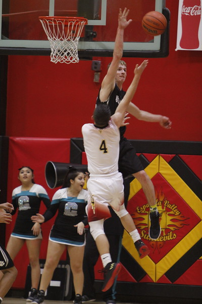 Capital's Matt Smith, number 22, blocks a shot from Española's Isaiah Vigil, number 4, during the second quarter of the Española Valley High School vs Capital High School boys basketball game at Española on Tuesday, January 23, 2018. Luis Sánchez Saturno/The New Mexican