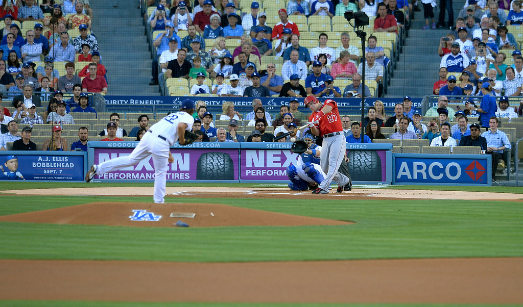 . In the first inning, Angels Mike Trout hits the ball for a single in the first inning as he faced Dodger pitching ace Clayton Kershaw for the first time in a historic moment in baseball. Los Angeles CA. 8/5/2014(Photo by John McCoy Daily News)