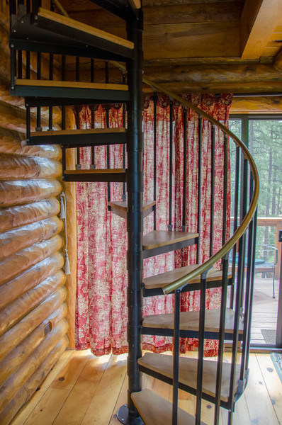 A spiral staircase takes you up to the loft.