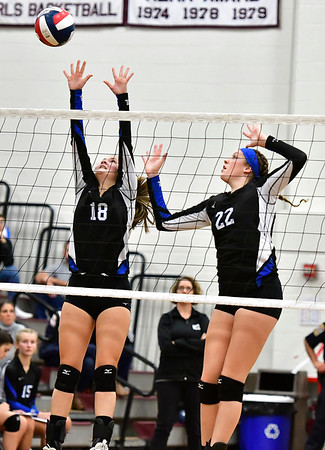 10/30/2019 Mike Orazzi | StaffrBristol Eastern's Leah Chipman (18) and Hannah Webber (22) during Wednesday night's volleyball match at Bristol Central.