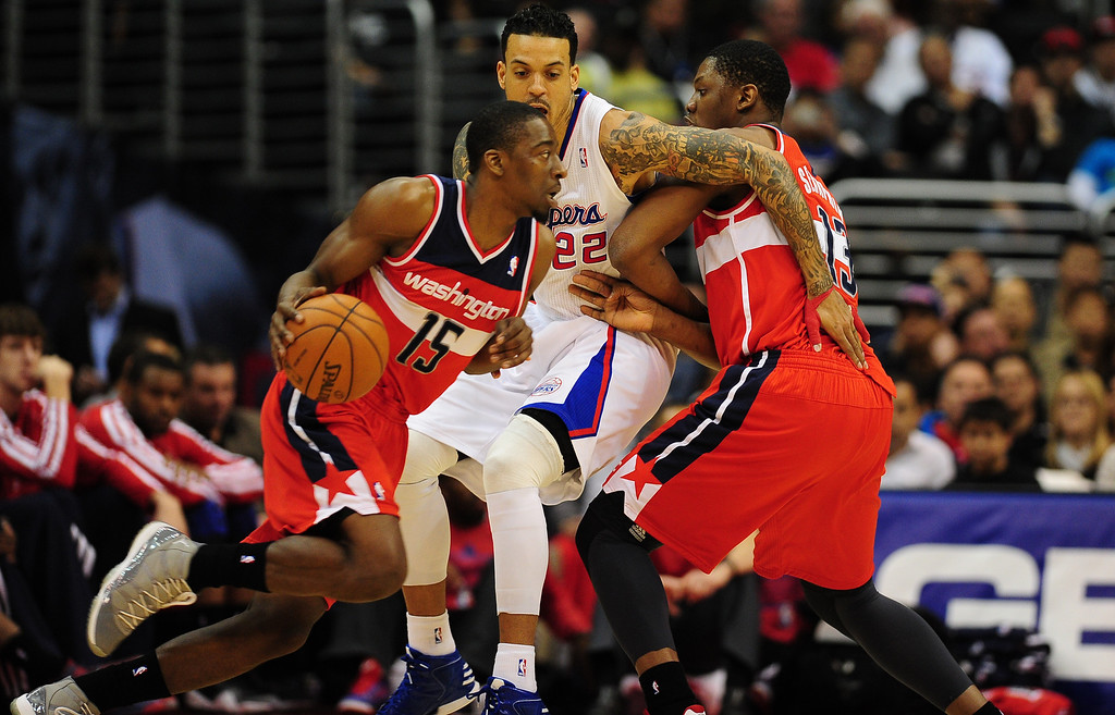 . Kevin Seraphin (R) of the Washington Wizards plays tough defense on Matt Barnes of the Los Angeles Clippers (C) as Jordan Crawford (#15) dribbles during their NBA game in Los Angeles on January 19, 2013.  FREDERIC J. BROWN/AFP/Getty Images