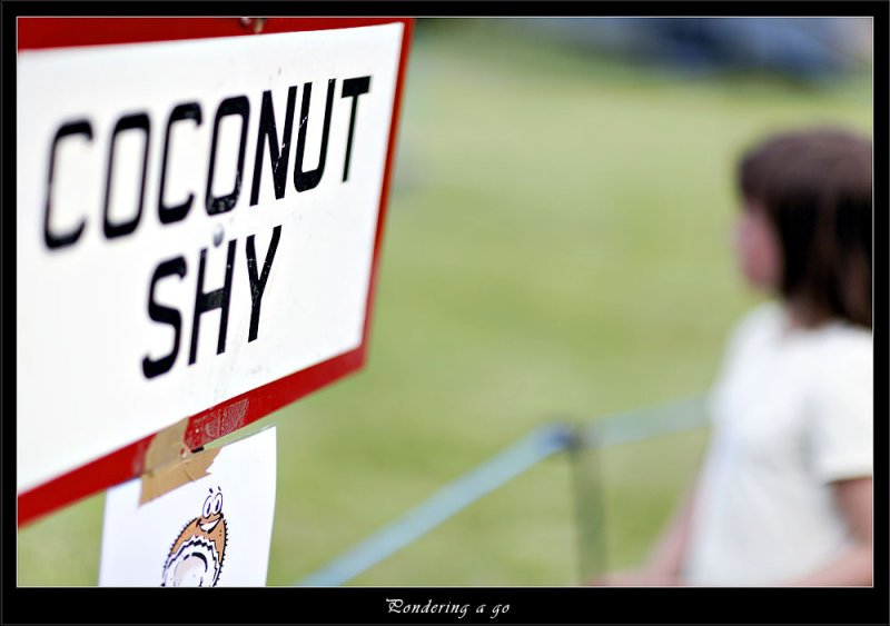 Girl pondering trying for a coconut (80575633).jpg