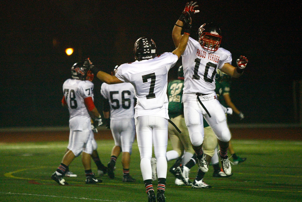 . Wide receiver Lance Brown #7 and Tanner Tellenbach #10 of Palos Verdes celebrate after Brown\'s touchdown catch against the defense of Mira Costa in a Bay League matchup at Mira Costa High School on Friday, October 18, 2013 in Manhattan Beach, Calif.  (Michael Yanow / For the Daily Breeze)