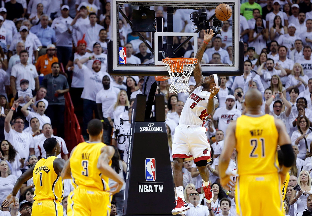 . Miami Heat\'s LeBron James (2nd R) goes up to score against the Indiana Pacers during Game 7 of their NBA Eastern Conference final basketball playoff in Miami, Florida June 3, 2013. REUTERS/Joe Skipper