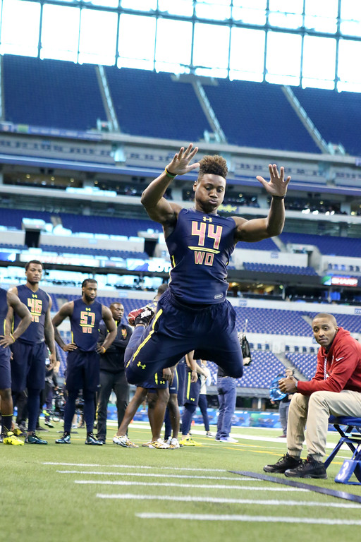 . Ohio State wide receiver Curtis Samuel is seen in the broad jump at the 2017 NFL football scouting combine Saturday, March 4, 2017, in Indianapolis. (AP Photo/Gregory Payan)