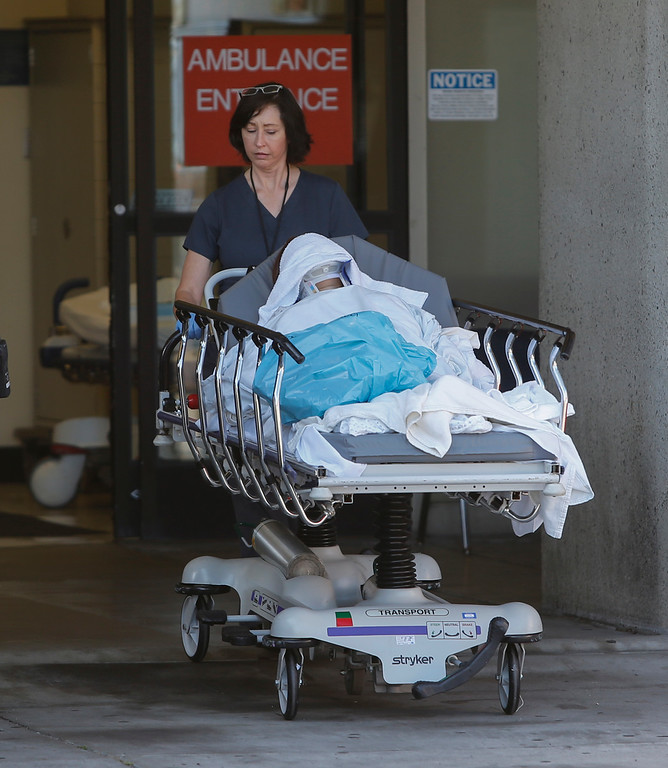 . A patient is taken to the triage tent at San Francisco General Hospital on Saturday, July 6, 2013. Not sure if they were a passenger on the Asiana Airlines Flight 214 that crashed at SFO today.(John Green/Bay Area News Group)