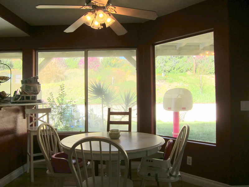 Convenient eat-in kitchen with ceiling fan...