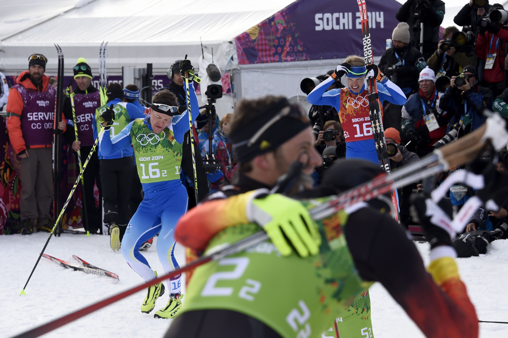 . Gold medalists Finland\'s Sami Jauhojaervi (bacK L) and Finland\'s Iivo Niskanen (16 R) react at the finish line of the Men\'s Cross-Country Skiing Team Sprint Classic Final at the Laura Cross-Country Ski and Biathlon Center during the Sochi Winter Olympics on February 19, 2014 in Rosa Khutor near Sochi. (ODD ANDERSEN/AFP/Getty Images)