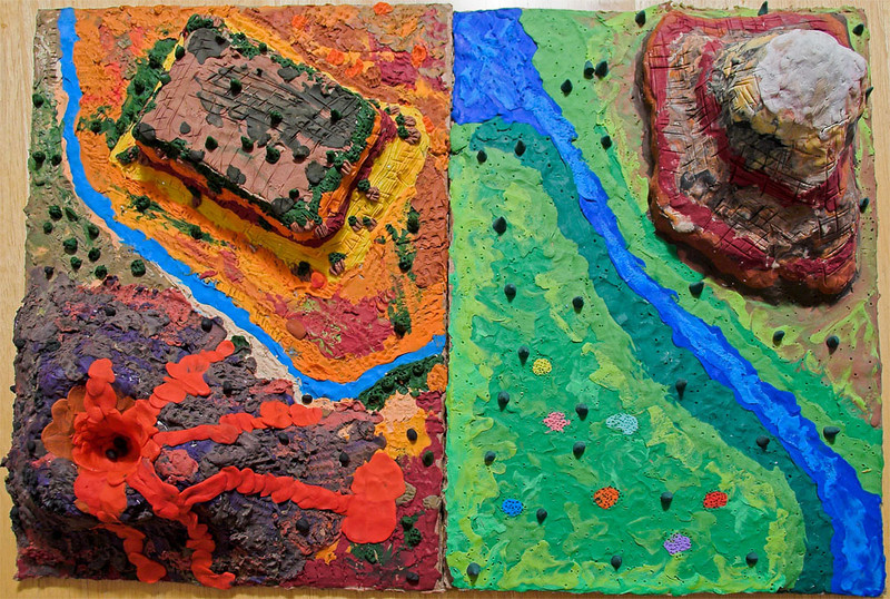 Landforms: a school assignment to pick 3 types of landforms, do a little research on each, write a little paragraph on each, and draw, paint or sculpt each.  We made it a family project and had a lot of fun.  Left side: Joshua's Volcano, River, and Mesa (a mountain with a flat top).  Right side: Abigail's Plain, River, and Mountain. More views next.