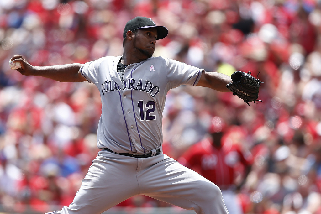 . Juan Nicasio #12 of the Colorado Rockies pitches in the third inning of the game against the Cincinnati Reds at Great American Ball Park on May 11, 2014 in Cincinnati, Ohio. (Photo by Joe Robbins/Getty Images)