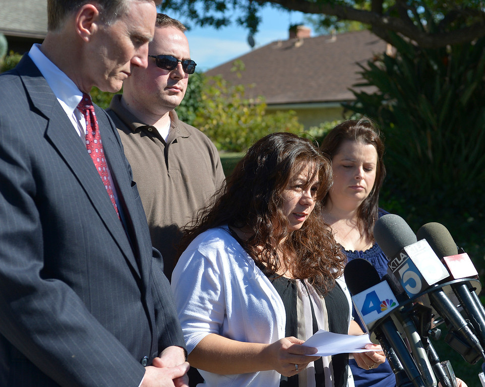 . Ana Hernandez stands with TSA Administrator John Pistole and friends Joshua Rowley and Amy Sharp. Hernandez held a press conference on the front lawn of her home the day after her husband, TSA Behavior Detection Officer Gerardo Hernandez, was killed by a gunman in Terminal 3 at Los Angeles International Airport. Los Angeles, CA. 11/2/2013. photo by (John McCoy/Los Angeles Daily News)