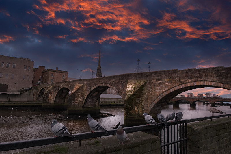 The Auld Brigg Ayr Scotland as the town was covered by a dramatic sunset.