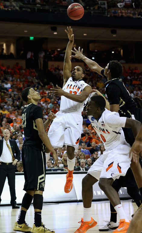. AUSTIN, TX - MARCH 22:  Tracy Abrams #13 of the Illinois Fighting Illini takes a shot over Andre Roberson #21 of the Colorado Buffaloes during the second round of the 2013 NCAA Men\'s Basketball Tournament at The Frank Erwin Center on March 22, 2013 in Austin, Texas.  (Photo by Stephen Dunn/Getty Images)