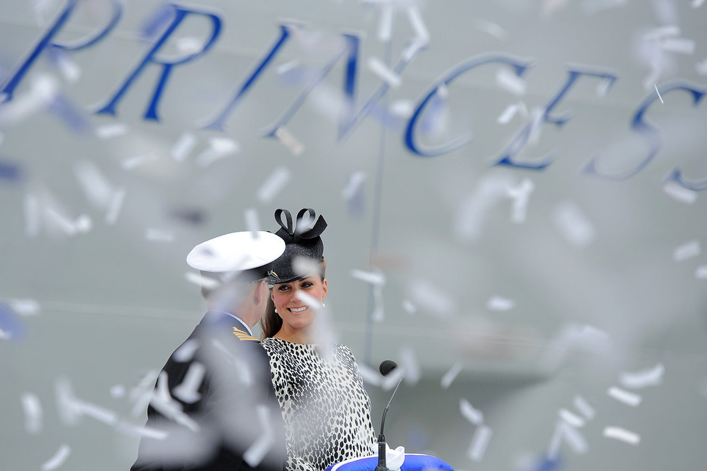. Ticker tape falls as Britain\'s Catherine, Duchess of Cambridge (R) officially names Princess Cruises\'s new ship \'Royal Princess\' in Southampton, southern England on June 13, 2013. The Duchess of Cambridge, as the ship\'s godmother, officially named the Royal Princess with a traditional blessing involving smashing a bottle over the ship\'s hull in what is expected to her final solo engagement before the birth of her and Prince William\'s child.  BEN STANSALL/AFP/Getty Images