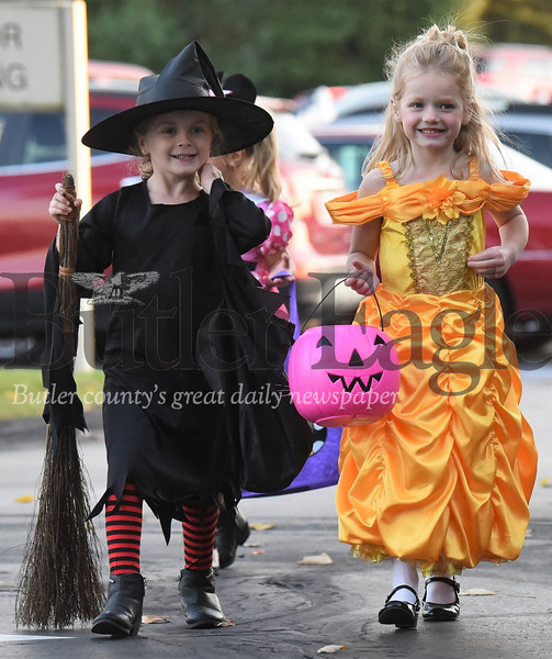 Tricker treaters at the New Haven Court at Clearview retirement home Tuesday. Costume-clad kids crowded the halls  and made their rounds in the senior community trick-or-treating with residents a of the home. Seb Foltz/Butler Eagle