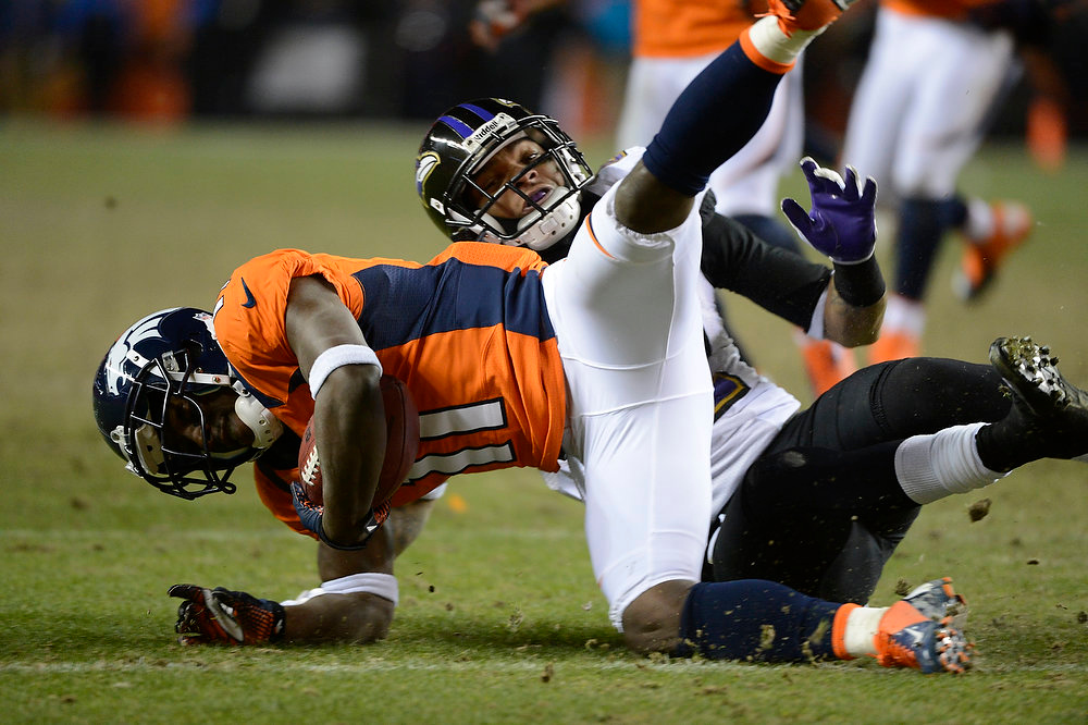 . Denver Broncos wide receiver Trindon Holliday (11) is tackled far in the Broncos end on a punt return in overtime. The Denver Broncos vs Baltimore Ravens AFC Divisional playoff game at Sports Authority Field Saturday January 12, 2013. (Photo by Joe Amon,/The Denver Post)