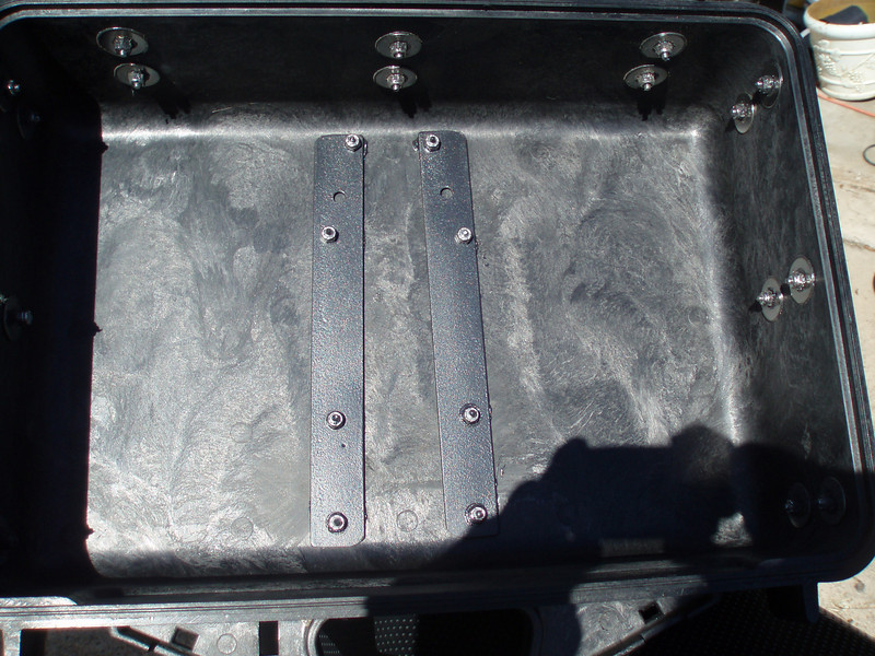 """The mounting and locking gadgetry is reinforced with 1"""" flatbar inside the case. I also used polyurethane sealer around all the bolt holes."""