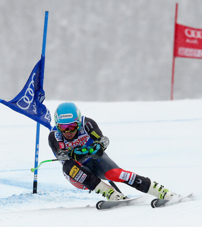 . Ted Ligety clips a gate on his way to the finish line during the men\'s World Cup super-G skiing event, Saturday, Dec. 7, 2013, in Beaver Creek, Colo. Ligety finished fourth in the race. (AP Photo/ Charles Krupa)